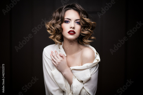 Beauty styled closeup portrait of a young woman - 62532373