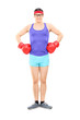 Young athlete posing with boxing gloves