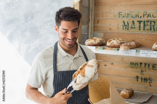 Male cafe owner with sweet food at coffee shop