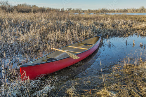 red canoe in a wetland