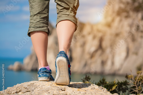 female feet in sneakers