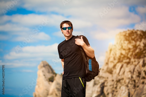 Hiker with backpack enjoying landscape