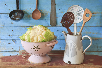 fresh cauliflower and vintage kitchen utensils, free copy space