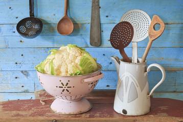 fresh cauliflower and vintage kitchen utensils, free copy space