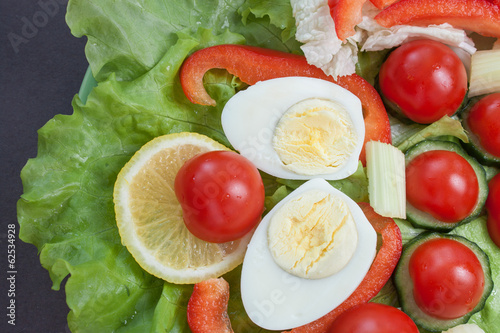 Closeup of fresh sliced vegetables and boiled egg