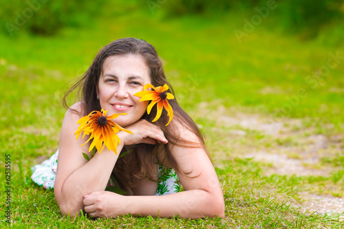 Young woman with rudbeckia