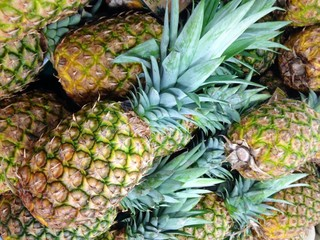 Beautiful selection of fresh pineapple at the farmers market.