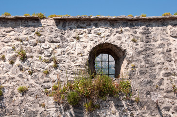 Medieval stone wall with small window