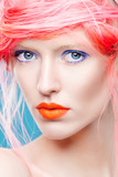 Portrait of beautiful girl with pink hair and orange lips