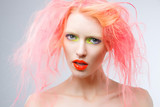 Portrait of beautiful girl with pink hair