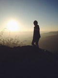 human silhouette on mountain with beautiful sunrise