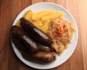 czech food - black and white pudding with potatoes and sauerkrau