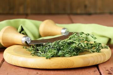 Fresh fragrant green thyme on a cutting board