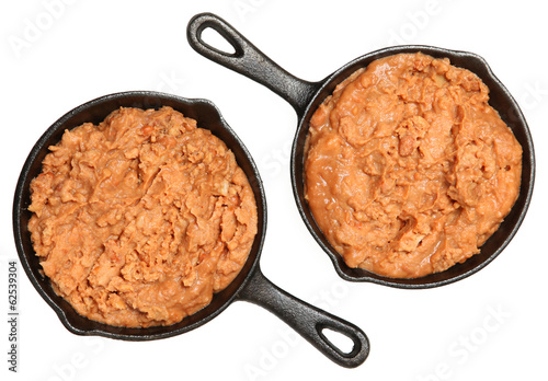 Refried Beans in Skillets Over White