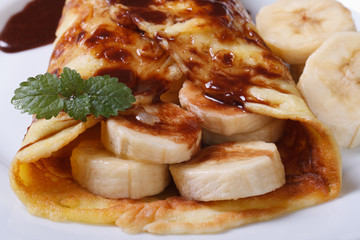 delicious crepe with banana close-up on a plate
