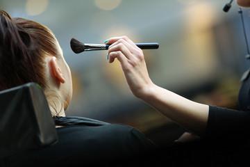 Young girl during makeup process
