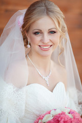 Beautiful Bride in wedding day outdoors