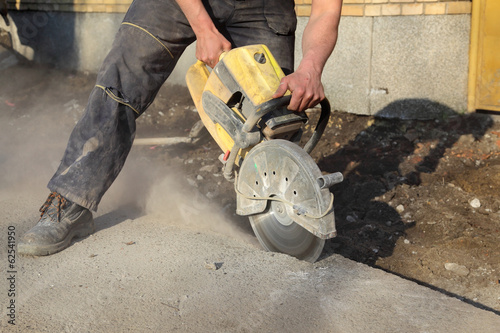Construction site, asphalt or concrete cutting with saw blade