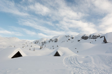 Mountain cottages covered in snow