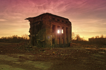 destroyed building at sunset