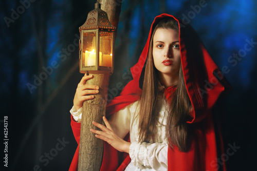 Little Red riding hood lighted by a lantern