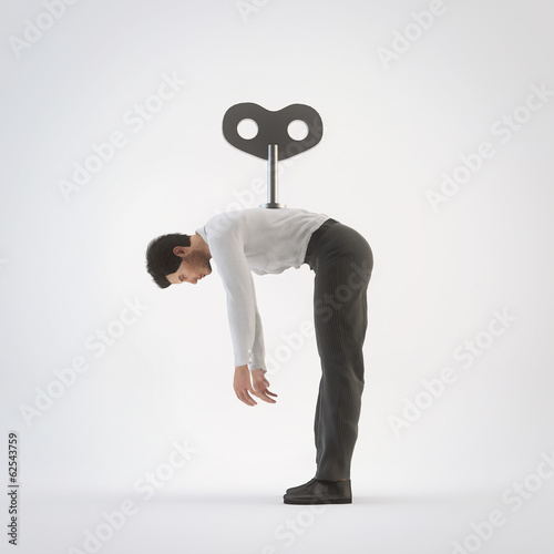 Businessman with a key winder on her back sleeping