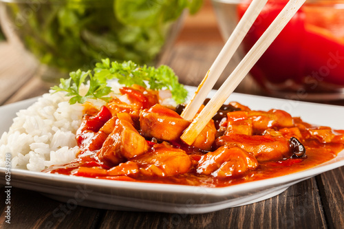 Sweet and sour chicken with rice - 62543928