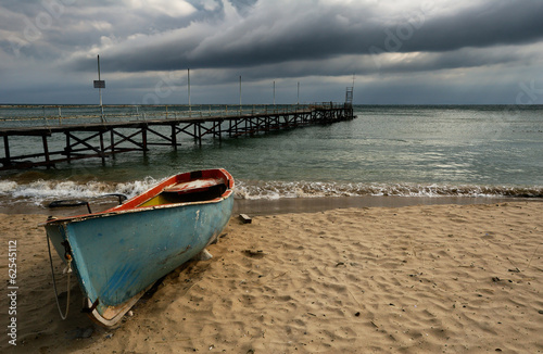 Boat on cloudy beach