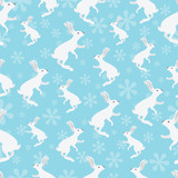 Rabbit seamless pattern on blue background.