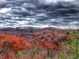 Dramatic sky, autumn mountain forest