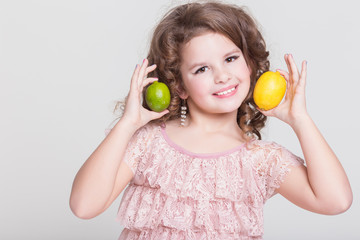 Child little girl eating healthy bio fruits