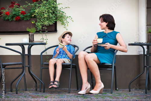 Young mom having coffee with her son