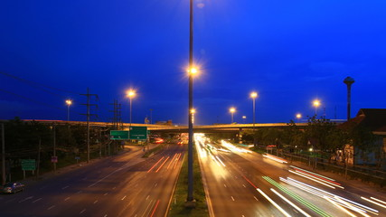Highway traffic time lapse evening to night