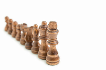 Chess pieces aligned in a white background isolated, top view