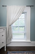 Window with blinds and curtain
