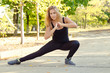 Woman working out doing stretching exercises