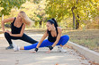 Two fit athletic woman working out in a park