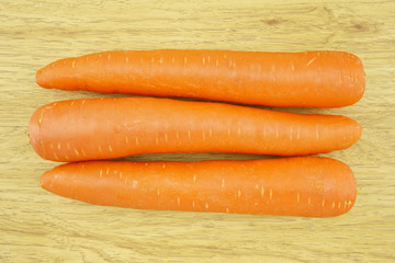 Fresh carrot wood background