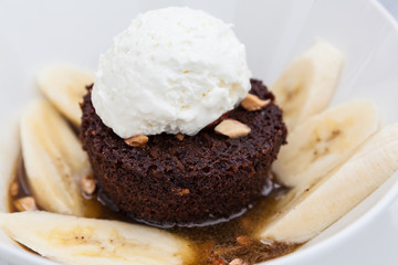Chocolate brownie with bananas and whipped cream