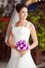 Beautiful Bride in wedding day outdoors, vintage grain