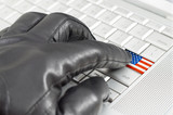 Hacking USA concept with hand wearing black leather glove pressi