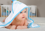 Cute baby boy in a hooded towel after bath