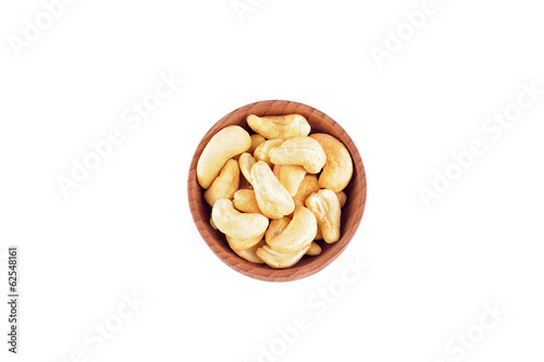 Cashew nuts in the wooden bowl