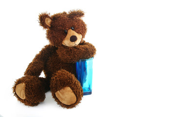 Teddy bear with a blue transparent glass