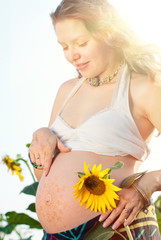 Pregnant woman with bodyart