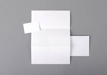 Blank basic stationery. Letterhead folded, business card, envelo