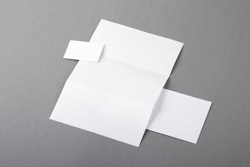 Blank basic stationery. Letterhead folded, business card, envelo
