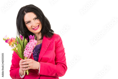 Happy woman holding spring flowers