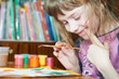 Girl painting in preschool