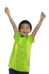 adorable kid celebrating success with his raised hands